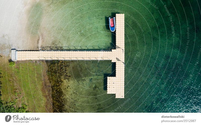 Bootssteg Fernreisen Fernweh pleite Corona Urlauber menschenleer Tourismus Sommerurlaub Reisebeschränkung Ferien & Urlaub & Reisen See Menschenleer Tag Wasser