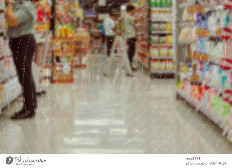 Abstrakte verschwommene Waren im Supermarkt abstrakt Hintergrund Unschärfe hell Business kaufen Gewerbe Konzept Verbraucher Konsumverhalten Kunde defokussiert