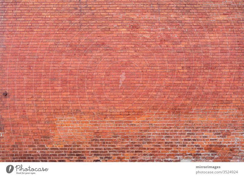 Fernes Gebäude rote Ziegelwand Oberfläche Körper Hintergrund volle Wand entfernte Ziegelmauer Gebäude rote Backsteinmauer Maurerhandwerk texturiert Raum