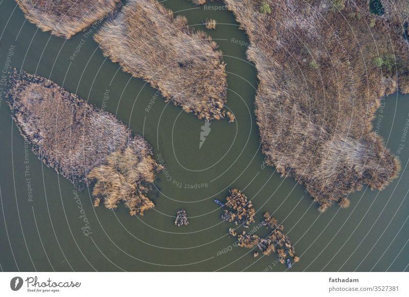 Luftaufnahme eines Sees mit Booten Wasser Ansicht reisen Tourist Tourismus Sommer Ufer malerisch Reflexion & Spiegelung Natur natürlich Landschaft Dröhnen