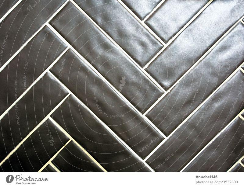 Moderne glänzend schwarze Fliesenoberfläche mit Hintergrundtextur, modernes Retro-Design, Architektur Wand Textur Fliesen u. Kacheln Muster Tapete abstrakt