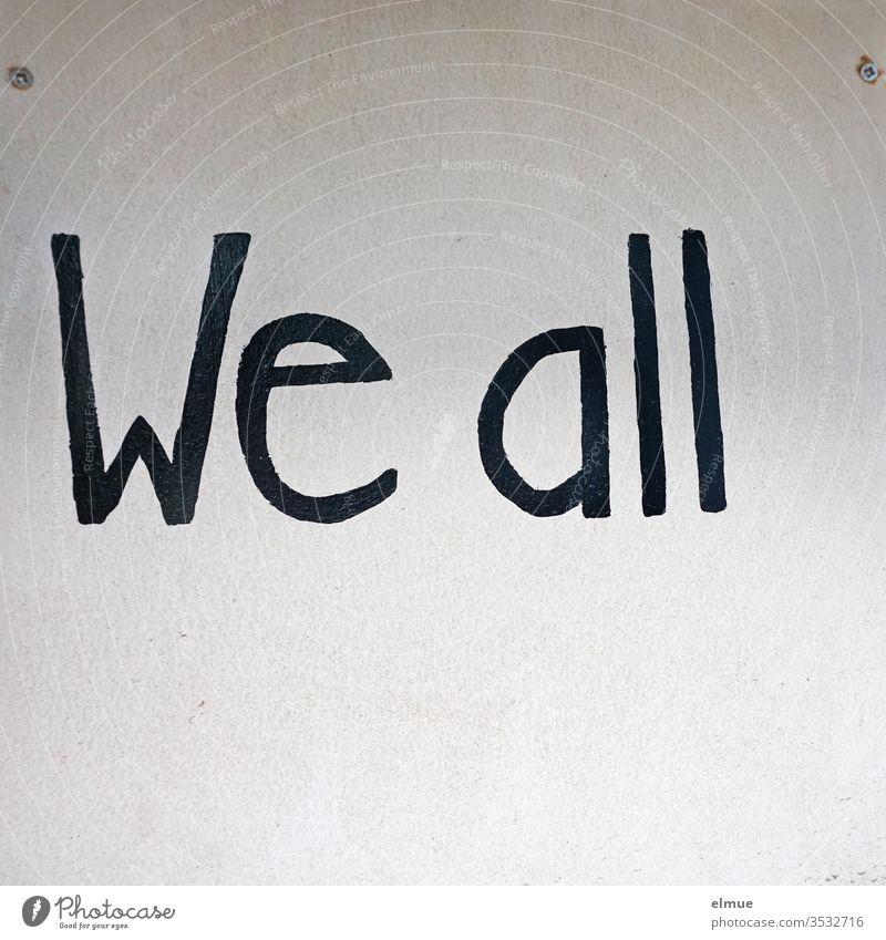 """schwarze Schrift """"we all"""" auf heller Platte anders sein Sinnspruch englisch wir alle Meinung dazugehören Druckbuchstabe Aussage Gefühl Redewendung Gesellschaft"""