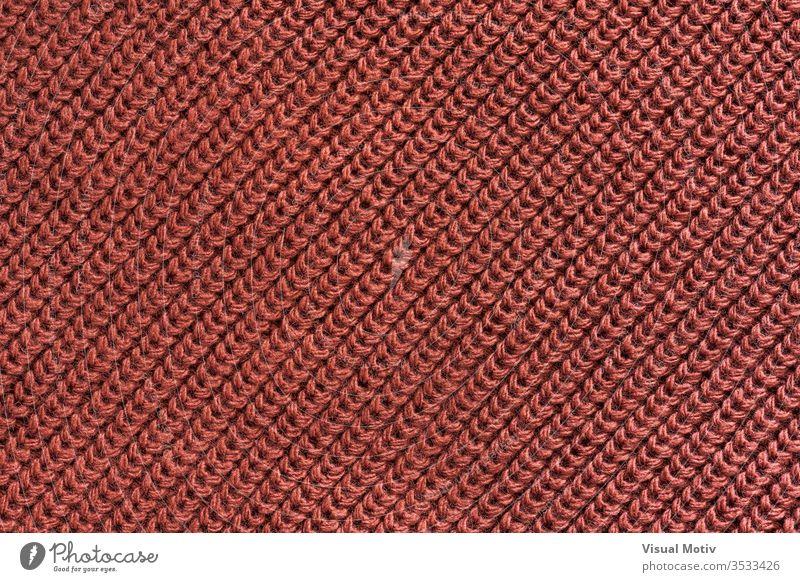 Textur eines Gestricks aus roter Wolle Textil texturiert Mode Gewebe Hintergrund Oberfläche Design abstrakt Nahaufnahme niemand Detailaufnahme Strickwaren