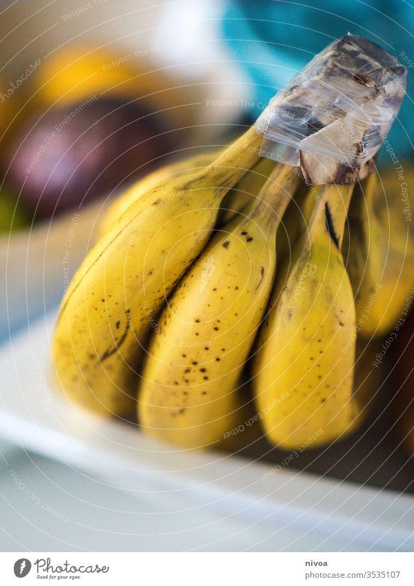 Bananen Frucht Zitrone Passionsfrucht Schalen & Schüsseln Speise Küche gelb abschließen Gesundheit Vitamin Nahaufnahme Zitrusfrüchte Farbfoto Ernährung Kalk