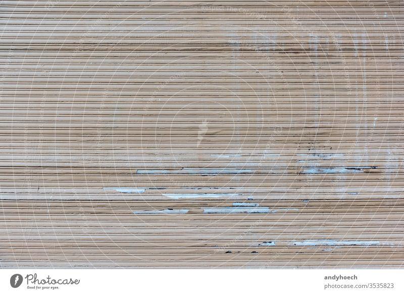 Ein alter geschlossener, kaputter brauner Rollladen Verlassen abstrakt Hintergrund Hintergründe blind Jalousien Gebäude gebaute Struktur zugeklappt Farbe