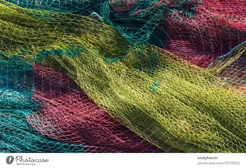 Fischernetze in der Morgensonne trocknen lassen abstrakt Kunst Hintergrund Hintergründe fangen abschließen Farbe farbig farbenfroh kommerzielles Fischernetz