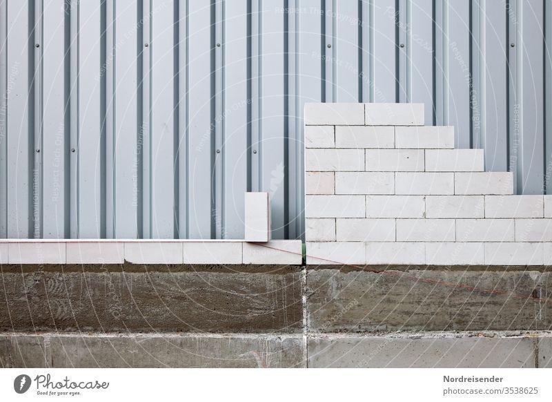 Berufsausbildung zum Maurer Textfreiraum unten Menschenleer Strukturen & Formen Muster Außenaufnahme Gedeckte Farben Farbfoto Mörtel Arbeitspause Fundament