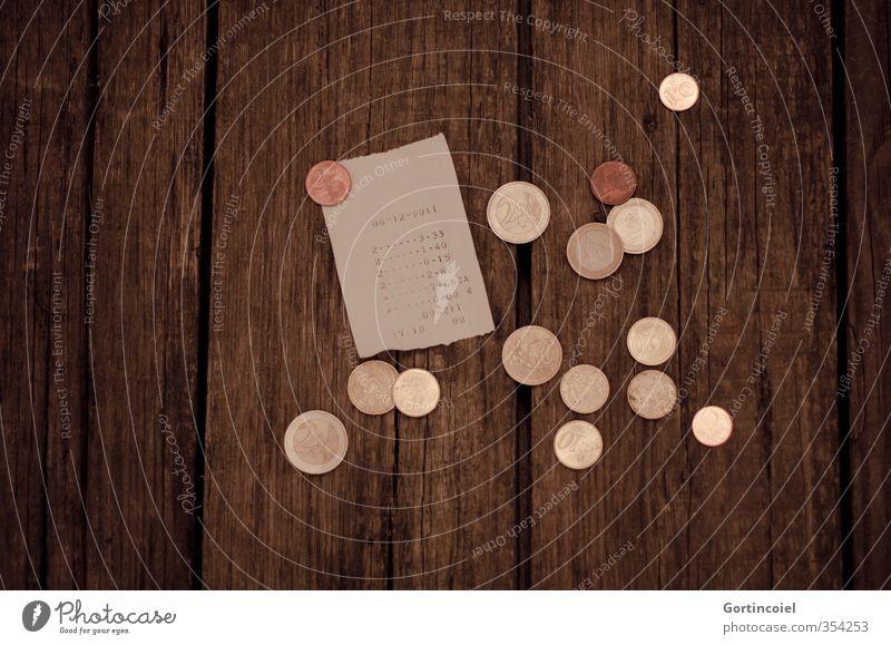 Kröten Geld bezahlen Eurozeichen Geldmünzen Holztisch Quittung