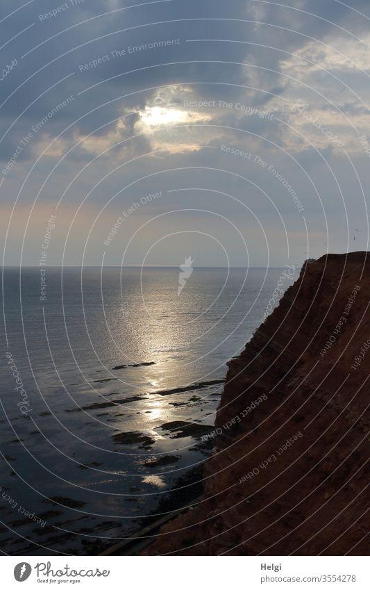 Abendstimmung an den roten Felsen auf Helgoland Sonnenuntergang Nordsee Insel Nordseeinsel Rote Felsen Steilküste abends Horizont Spiegelung Stimmung Himmel