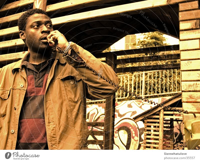 City of God Telefon Aktion Ghetto Mann mehrfarbig Blick Bewegung Braunstich Telefongespräch