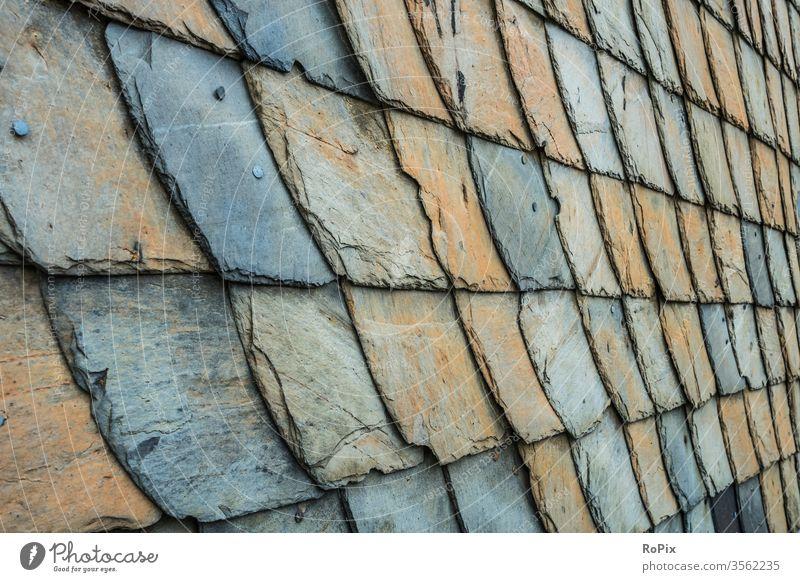 Detailansicht einer Schieferwand im Harz. Mauerwerk slate reinforcement Stein Naturstein Steinwand stone Wand wall Bauwerk Architektur Textur Struktur Haus
