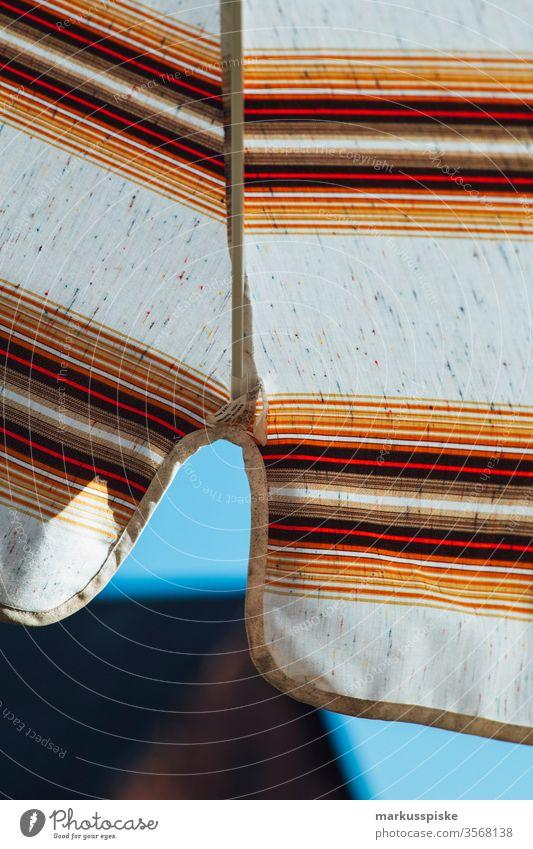 70ziger Sonnenschirm Muster 70s siebzig orange braun typisch