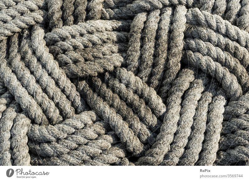 Muster aus geflochtenen Seilen. Strick Tau rope Schiff Anschlagmittel Hafen Technik Festigkeit Halt Seefahrt Business Gesellschaft Schiffsrumpf Gewerbe Geflecht
