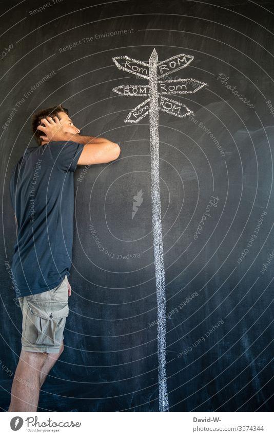 Viele Wege führen nach Rom | wörtlich genommen Mann Fragender Blick fragend nachdenklich viele Wege & Pfade Schilder Wegweiser verlaufen Ziel