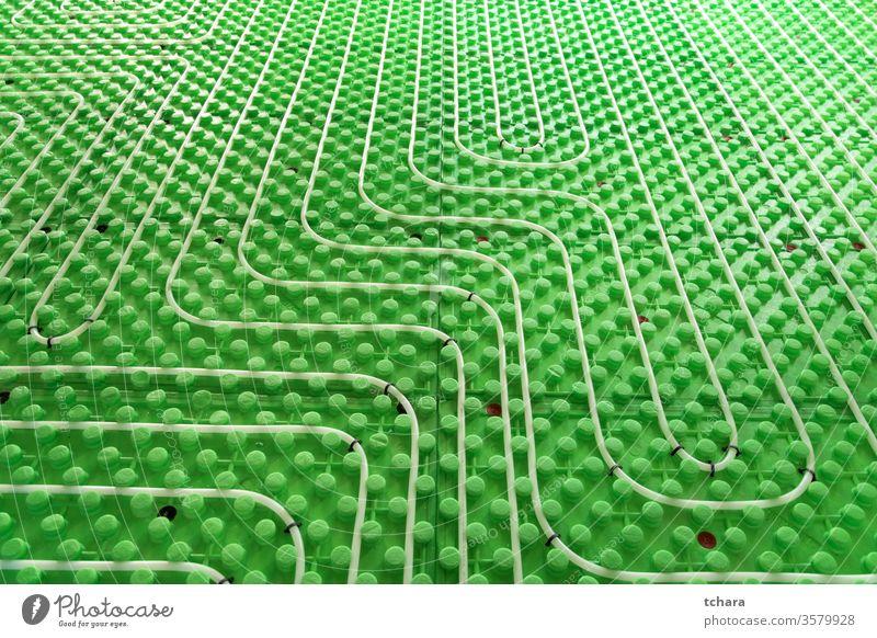 Teil einer Fußbodenheizungsinstallation Heizung Stock System Unterflur strahlend unten Konstruktion Wasser Kunststoff Tube Installation Haus heiß erwärmen