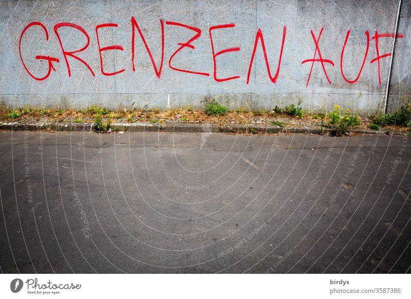 Grenzen auf. Forderung, bestehende Beschränkungen durch Corona zu lockern und  Grenzen wieder zu öffnen Graffiti Schriftzeichen Öffnung coronavirus