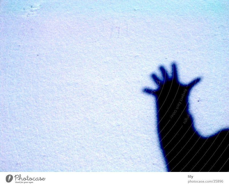 schattige Hand Sonne Schnee Gruß