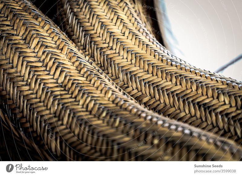 Rohrmöbel-Webmuster-Textur für Design-Hintergrund Handwerk handgefertigt abstrakt Antiquität Bambus Korb braun Stuhl abschließen Nahaufnahme Dekor