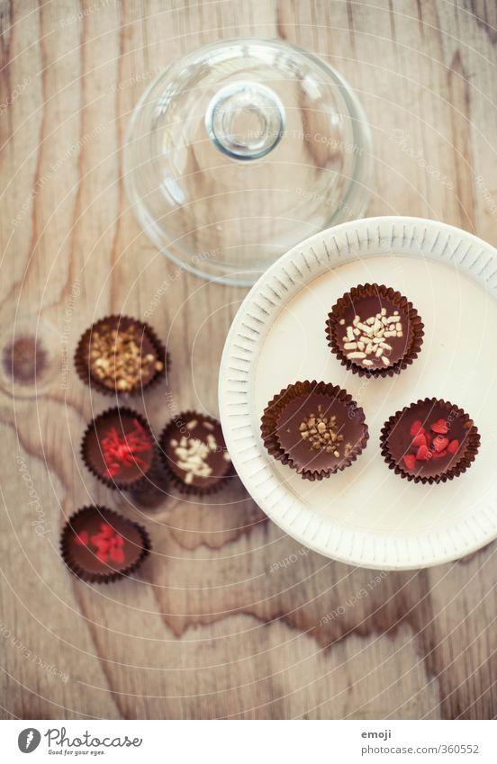 Pralinés Dessert Süßwaren Schokolade Ernährung Slowfood Fingerfood lecker süß Konfekt Farbfoto Innenaufnahme Menschenleer Tag Schwache Tiefenschärfe