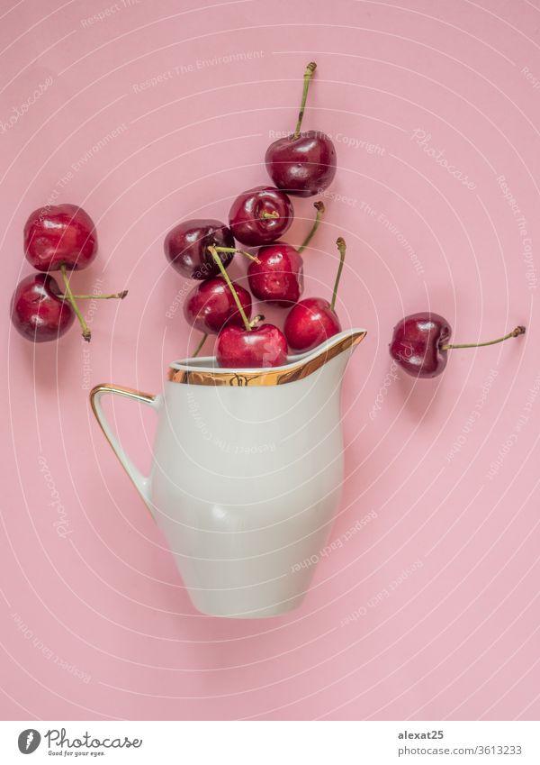 Kirschen in weißer Schale auf rosa Hintergrund Ackerbau Beeren Schalen & Schüsseln Farbe essen Lebensmittel frisch Frische Frucht Garten Feinschmecker