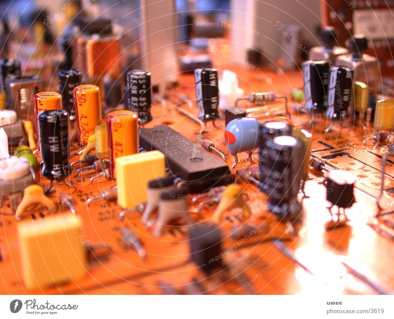components [elec.] Platine Elektrisches Gerät mehrfarbig Transistor Kondensator Kühlkörper Baustein Elektrizität Teile u. Stücke Technik & Technologie
