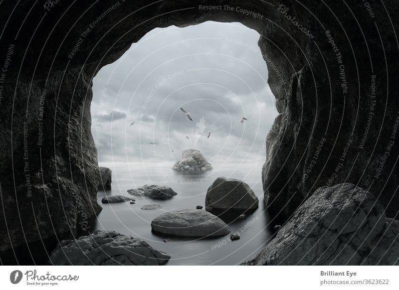 Höhle mit Sicht zum Meer malerisch Bucht Klippe Steine Küste Ufer Uferlinie Ausflugsziel Landschaft Felsen felsig Szene Meereslandschaft Ansicht Saison Himmel