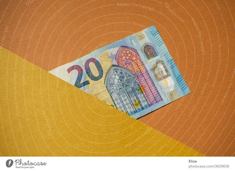 20 Euro Schein. Geldschein. Geld. halb verdeckt Textfreiraum grafisch Kapitalwirtschaft sparen Bargeld einzeln blau gelb orange beige
