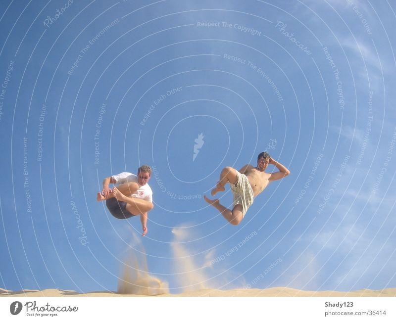 together on the sand Himmel blau Ferien & Urlaub & Reisen Strand Sand springen