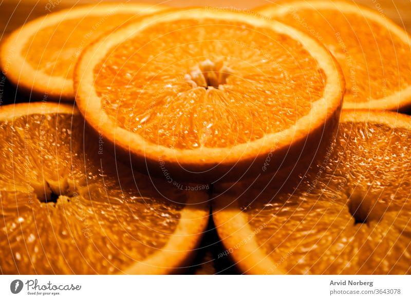 Frisch geschnittene kreisförmige Orangenscheiben abstrakt Hintergrund kreisen Zitrusfrüchte Nahaufnahme Farbe Dessert Diät essen Essen Lebensmittel frisch
