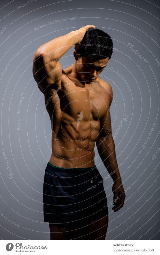 Asiatisches Fitness-Modell beugt muskulöses Abdomen Nam Vo männlich asiatisch Muskeln Stärke Sport sportlich Studioaufnahme menschlicher Körper Physis Torso