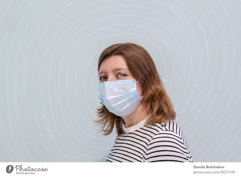 Frau, die eine Anti-Virus-Schutzmaske trägt, um Grippeinfektionen, Allergien, Virenschutz, COVID-19 und Coronavirus-Pandemie 2019 zu verhindern 2019-ncov Pflege
