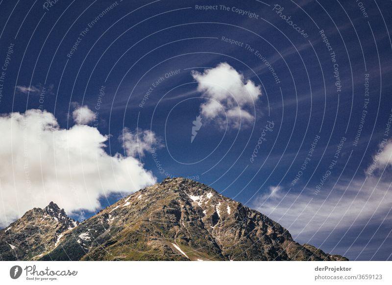 Wolken und Berge in St. Moritz Naturschutz Schweiz Graubünden Tatkraft Engadin wanderlust Willensstärke Starke Tiefenschärfe Optimismus Textfreiraum unten