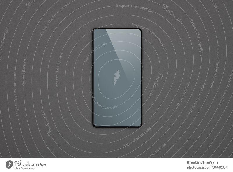 Schwarzes Smartphone mit leerem Bildschirm über grau eine schwarz Hintergrund blanko Nahaufnahme Funktelefon Telefon PDA Gerät Apparatur Mobile