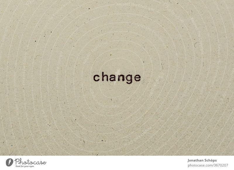Change als Text auf Papier mit Schreibmaschine Corona Coronakrise Coronavirus Covid-19 Recycling Schrift Typografie Veränderung analog englisch retro text