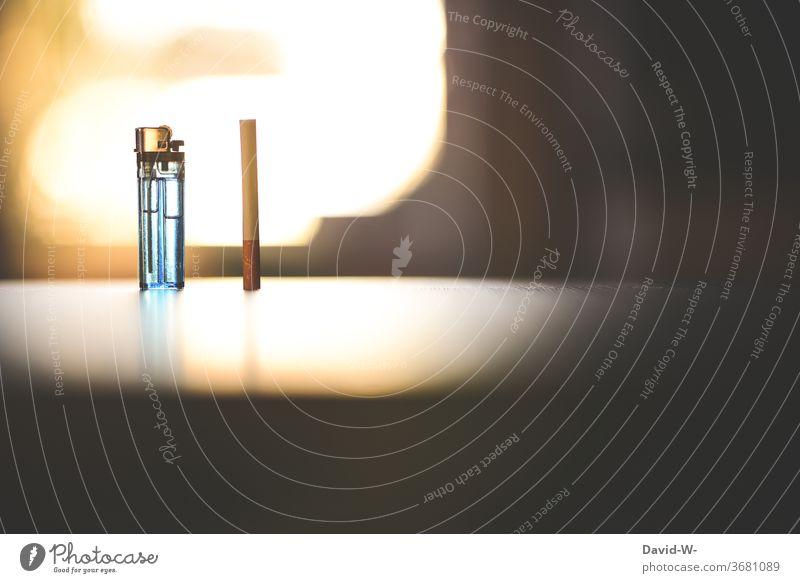 Thema : Rauchen - Zigarette und Feuerzeug auf einem Tisch Zigaretten süchtig Sucht suchtverhalten Suchtstoff suchtproblem suchtgefahr Krebs Krankheit
