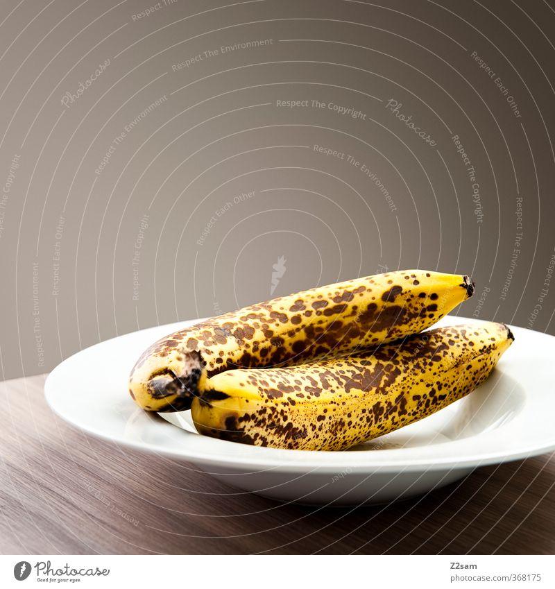 still Lebensmittel Frucht Banane Bioprodukte Vegetarische Ernährung Teller dunkel einfach elegant Gesundheit modern natürlich gelb ästhetisch Design nachhaltig