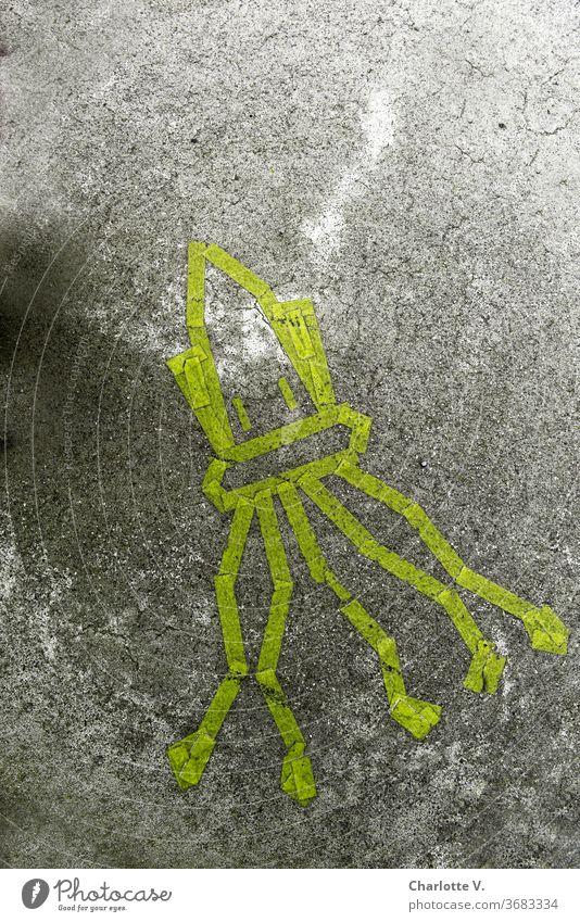 Gegensätze   Weiches Meeresgetier auf hartem Beton  Sepia Meerestier meeresgetier Betonboden Asphalt Klebeband geklebt Graffiti weich Gegensatz gelb grau