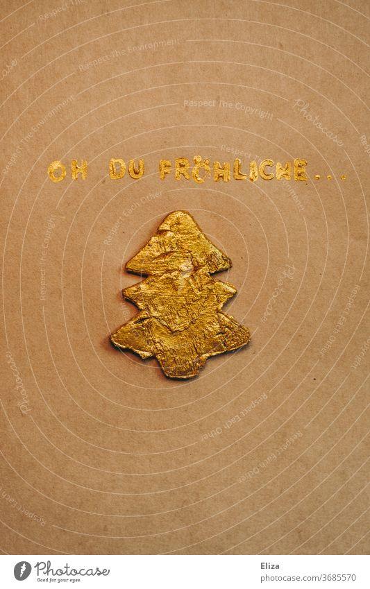 Oh du fröhliche Weihnachtszeit. Goldene Schrift mit goldenem Tannenbaum. Weihnachten. Weihnachtsbaum weihnachtlich singen Weihnachtslied Weihnachtsdekoration