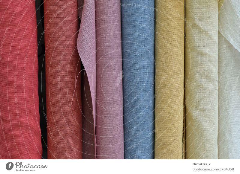 textiles Gewebematerial in verschiedenen Farben Brötchen Textil Hintergrund Monochrom Material Großhandel texturiert farbenfroh gerollt Beispiele Tonung