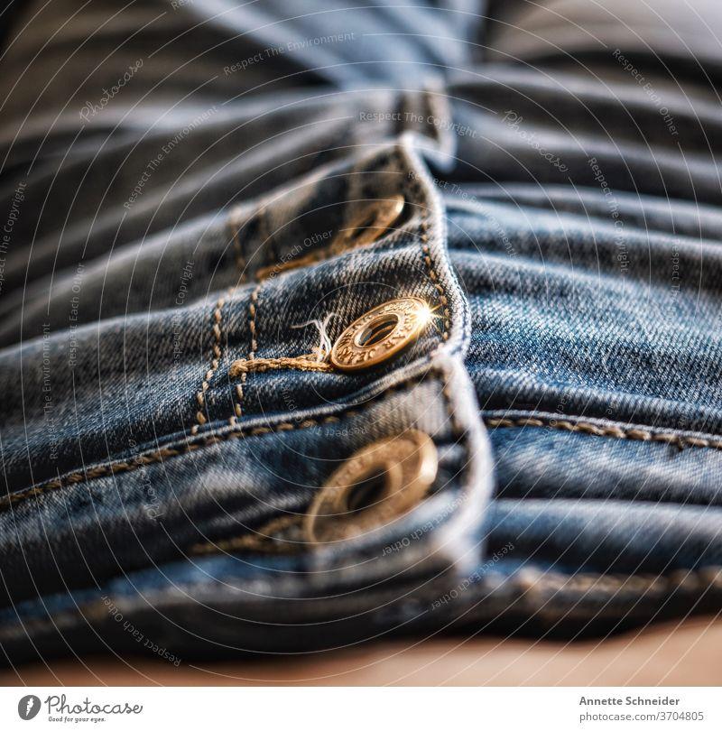 Jeansknöpfe Jeanshose Hose Mode Nahaufnahme Baumwolle Textil lässig Stoff Bekleidung Stil Knöpfe