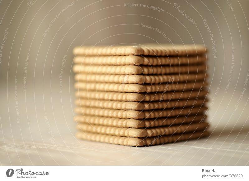 Gestapelt Teigwaren Backwaren Keks Butterkeks Ernährung hell lecker Ordnung stapeln Sammlung auftürmen Gedeckte Farben Innenaufnahme Menschenleer
