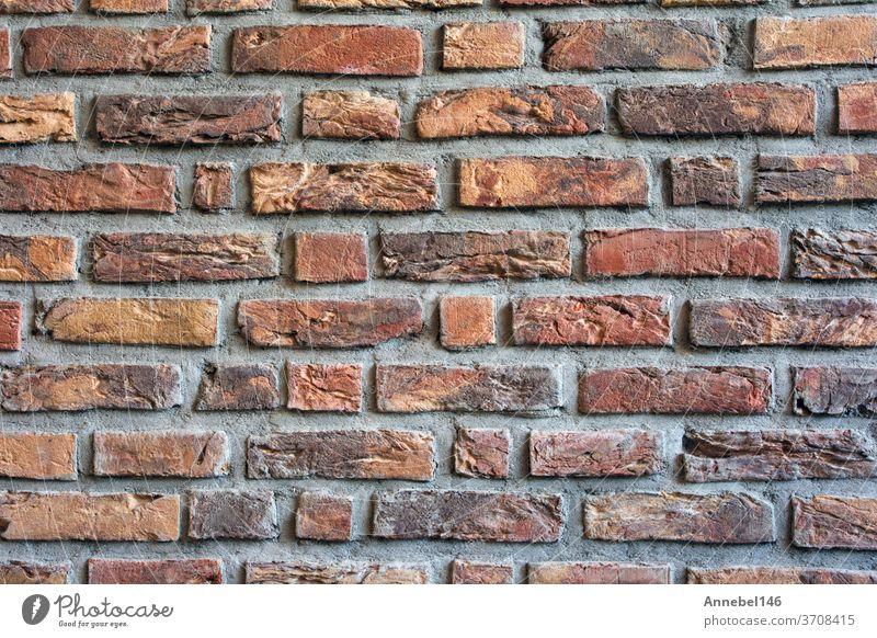 Ziegelwand dunkelrot gefärbt für Hintergrundtextur, moderner Retrostil Wand alt Textur Baustein Oberfläche rau Muster Mauerwerk Struktur Grunge braun Beton