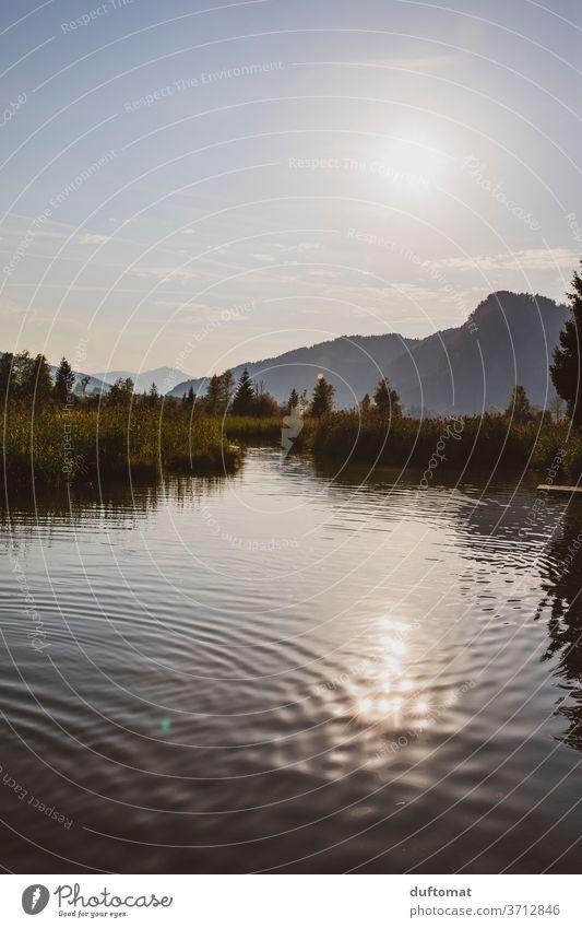 Blick über den See, Berge im Hintergrund Reflektion Wasser Natur Reflexion & Spiegelung reflektion ruhig Himmel Sonnenuntergang Glätte Licht Gewässer Idylle