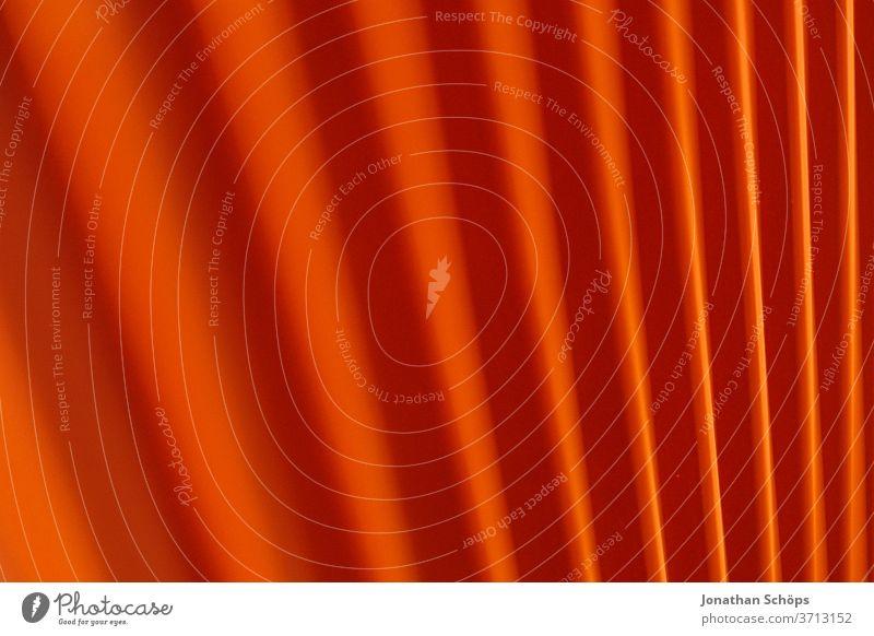 rotes Muster einer Heizung Hintergrundbild Innenaufnahme Lamellen Textur knallig metall schräg schwache Tiefenschärfe vertikal warm abstrakt Menschenleer