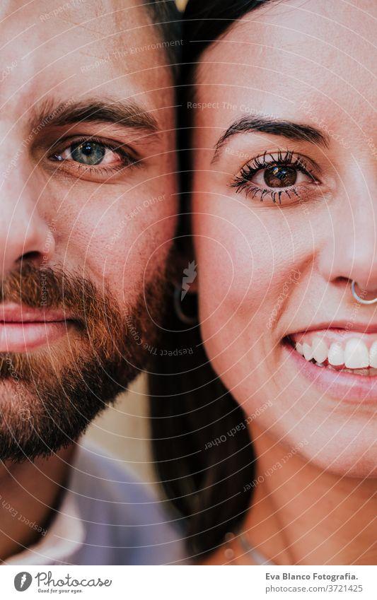 Nahaufnahme eines jungen glücklichen Paares zusammen. Augen aus nächster Nähe. Liebe und Familienkonzept abschließen Zusammensein Porträt Hälfte 2 Erwachsener