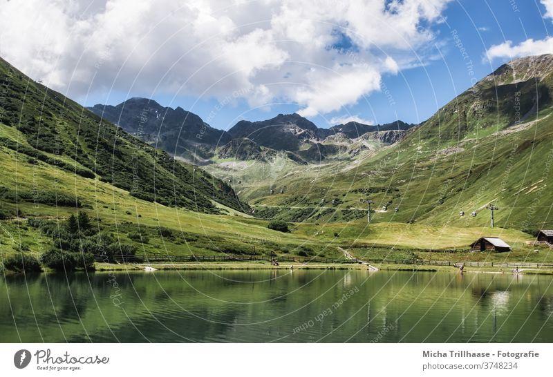 Serfaus-Fiss-Ladis, Österreich Alpen Berge Täler See Landschaft Natur Hüttenferien Berghütten Holzhütten Gras Bäume Weide Wiese Felsen Tourismus reisen wandern
