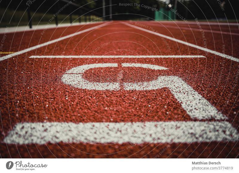 Laufbahn in Nahansicht Sport Leichtathlet Leichtathletik Laufsport laufen Joggen Ziel Ziellinie
