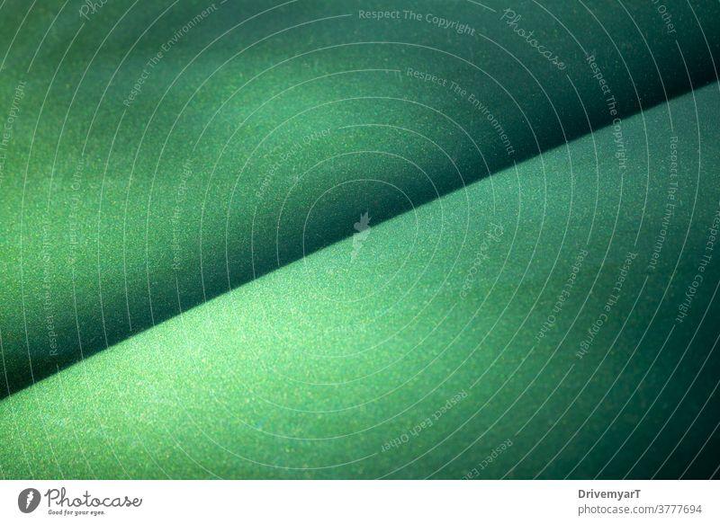 Grün metallisch glänzende Oberfläche mit einer diagonalen Linie Hintergrund grün Textur Blatt Metall Glitter graphisch Punkte Farbe Betrachtungen Kunst abstrakt