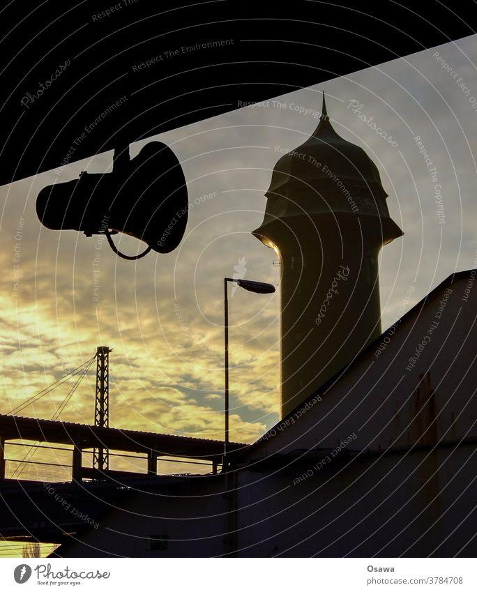 Wasserturm am Ostkreuz Bauwerk Gebäude Lautsprecher Berlin Friedrichshain Silhouette Gegenlicht Bahnhof Architektur Himmel Abend Wolken S-Bahn Bahnsteig Station