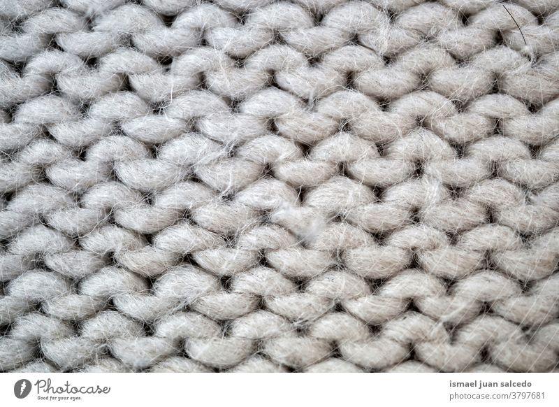 weiße Wolle, Tuch handgefertigt Faser grau Gewebe Stoff texturiert abstrakt Hintergrund Muster Material Industrie Textil Design Detailaufnahme Makro stricken